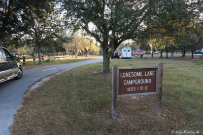Entrance to southern camping loop (Lonesone Lake) sites #1-12. Pull-through #1 on immediate right in back.