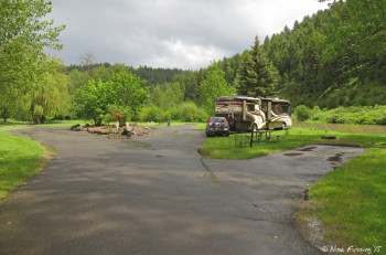 View of end of camping loop. Empty site on right #14, we're in #15, #16-#18 are around the back of the loop.