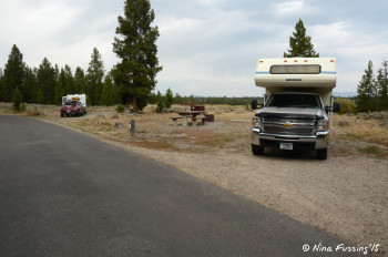 View of river-facing sites. Truck camper in #54 with trailer in #52 behind it.