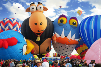 Balloons so crowded they kiss