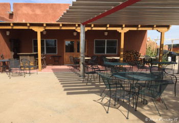 Open patio seating area by the main facilities. Anyone can use this.