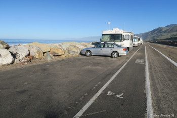 View of middle sites. Empty site #41 with RV in #73 behind it. The sea wall is rocky here and there's not a lot of extra space to maneuver. No way we could fit here.