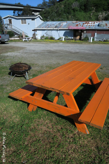 View of picnic table and moveable fire-pit. Only a few of these around.