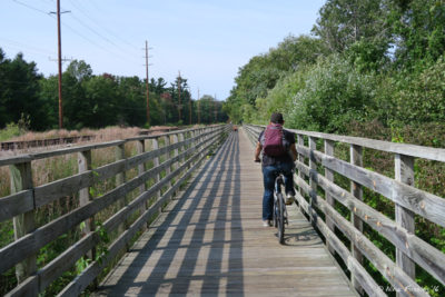 Riding the lovely bike trail to town just next to camp.