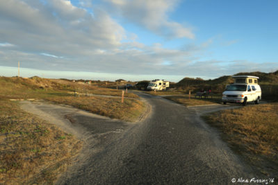 View down beginning of B Loop. Site B9 on Left, van in site B8 on right with B6 behind it.